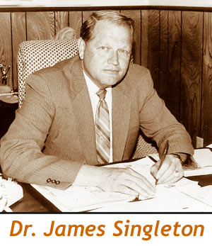 Singleton at desk